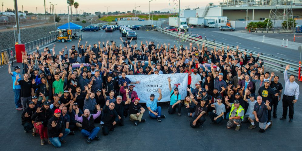 Tesla-employees-celebrate-Model-3.jpg