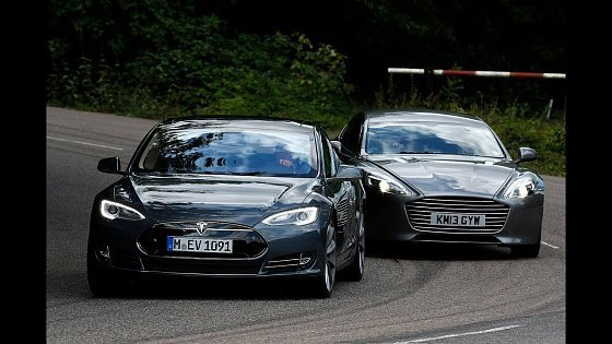Видео Tesla Model S takes on the Aston Martin Rapide S in the ultimate luxury saloon battle