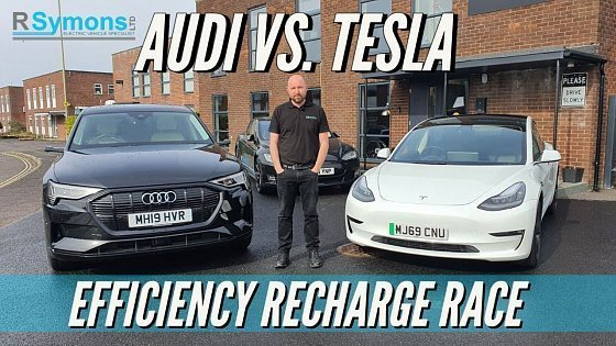 Видео Audi E-Tron v Tesla Model 3 Challenge! Point A to B and recharged EV race comparison. Who will win?